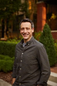 portrait of a man smiling at the camera with a checkered button up shirt. This is Billy Roberts, who is the owner of Open Pathways Counseling. He is a columbus ohio therapist that offers adhd therapy in columbus, oh, act therapy, humanistic therapy in columbus ohio, and other services!