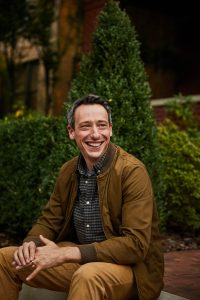 Portrait of man sitting and smiling. This is Billy Roberts, the owner of Open Pathways Counseling! He is a columbus ohio therapist that offers adult adhd therapy in columbus, oh, act therapy in columbus, oh, and other mental health services. Contact him today for support!