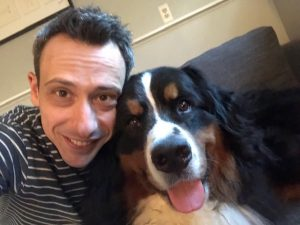 Man poses for a photo with his dog, Hagrid. His face is next to the dog's. This is Billy Roberts, the owner of Open Pathways Counseling. He offers act therapy in columbus, oh, adhd treatment for adults near me, and other mental health services. Contact him today for the support you deserve.
