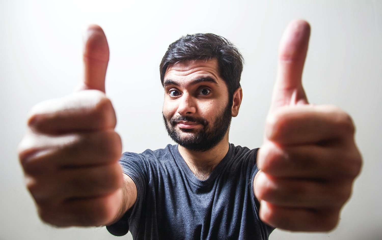 Man stands with two thumbs up as he smiles at the camera. He is feeling more focused after adult adhd therapy in columbus, oh. Open Pathways Counseling offers online adhd therapy in ohio, cbt for adult adhd in columbus, oh, adhd treatment for adults in columbus, ohio, and other services. Contact us today for the support you deserve