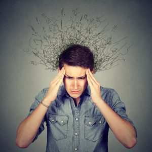 Stressed man holds his sides of his head as his fizzy hair makes exclamation points and question marks. He is struggling with ADHD, and just wants some relief. Open Pathways Counseling offers adult adhd treatment in columbus, oh, cognitive behavioral therapy for adult adhd in columbus, oh, and more. Contact us today.
