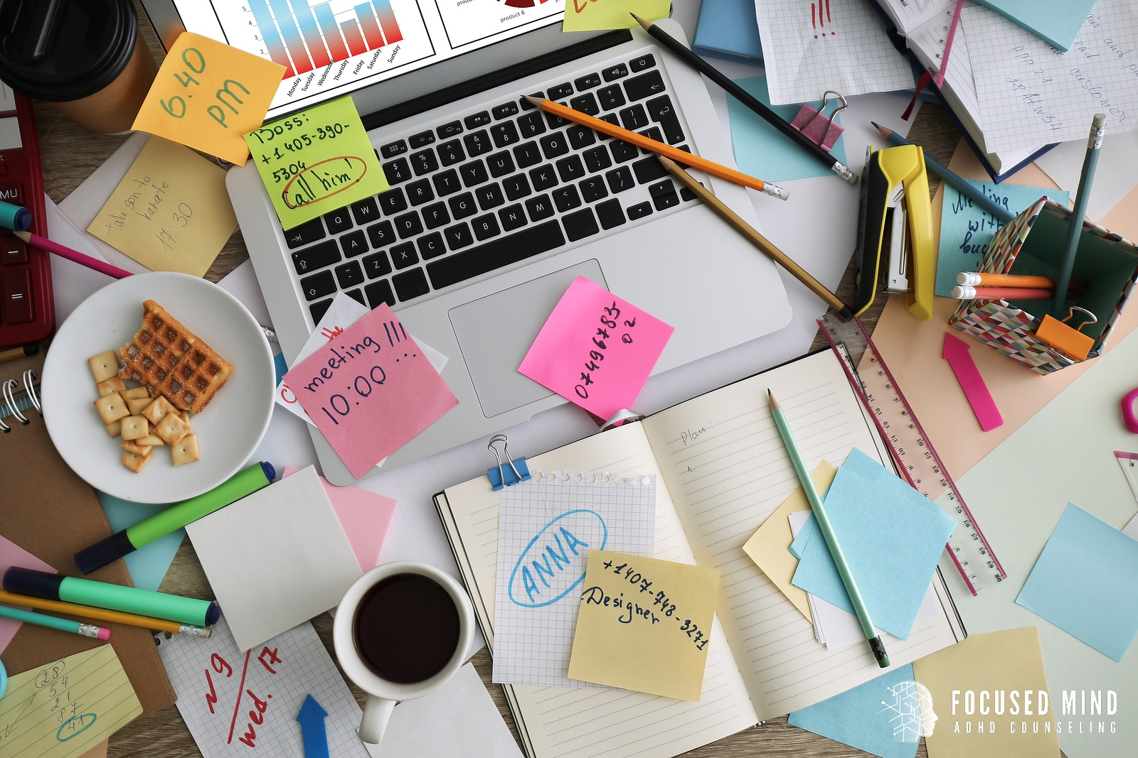 A top down perspective of a desk cluttered with post it notes, pencils, and other office supplies. This could symbolize the workspace of an adult with ADHD. We offer similar support for adult ADHD treatment in Ohio. Contact an adult ADHD specialist to start cbt for adult adhd and other services.