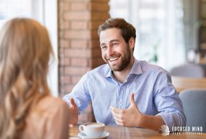 A smiling man appears confident as he talks with the woman across the table. He is gesturing with his hands while speaking. This could represent the confidence that can bloom from understanding one's adult ADHD symptoms. Get in touch with Focused Mind ADHD Counseling for ADHD testing in Columbus, OH. An adult ADHD specialist in Columbus, OH would love to assist you!