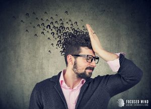 An annoyed looking man holds his hand against his forehead in disbelief. Question marks can be seen radiating from his confused head. This could represent the confusion that comes from not understanding adult ADHD symptoms. We offer support for ADHD in adults. Contact Focused Mind ADHD Counseling & get in touch with an adult ADHD specialist today!